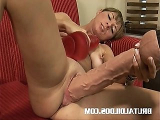 Patricia barely squeezes two giant dildos in her tight pussy