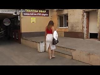 Secretary Irina barefoot in city dirty feet