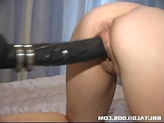 French brunette babe gets fucked by brutal dildo machine