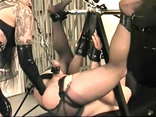 Fistfuck in bondage by latex beautiful mistress